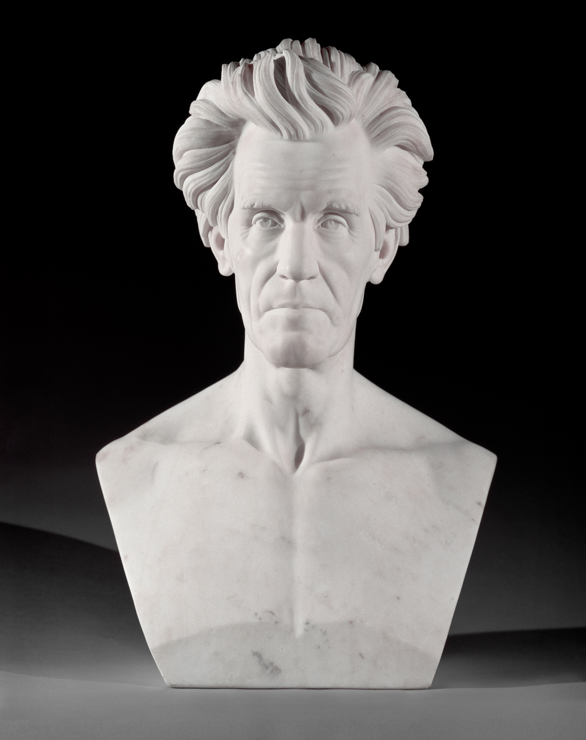 Plaster sculpture of a bare-chested man with full hair