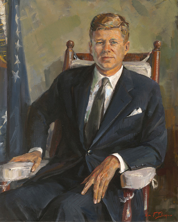 knee-length portrait of a man in a suit sitting in a rocking chair,